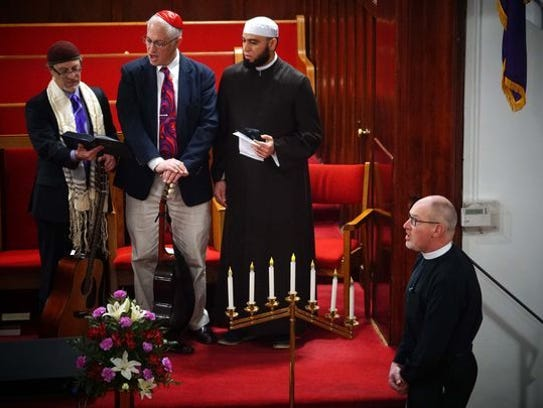 From left, Rabbi Micah Becker-Klein, formerly of Temple Beth El, Rabbi Michael Beals of Congregation Beth Shalom and Imam Abdul Hadi Shehata of the Islamic Society of Delaware and the Rev. Doug Gerdts of First and Central Presbyterian Church sing a song during an interfaith prayer gathering at Bethel African Methodist Episcopal.