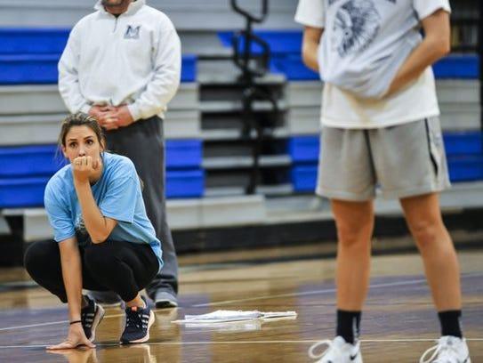Manasquan girls head coach Lisa Kukoda looks on during