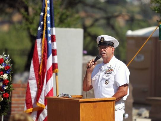 Navy Senior Chief Petty Officer Rob Burroughs speaks Monday during a Memorial Day service at Redding Memorial Park.