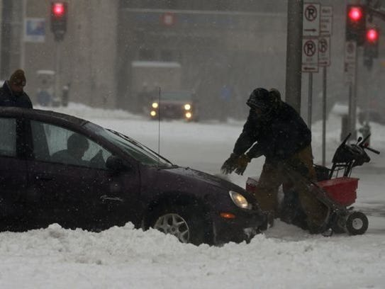 Cars get stuck in the street in Appleton on Saturday.