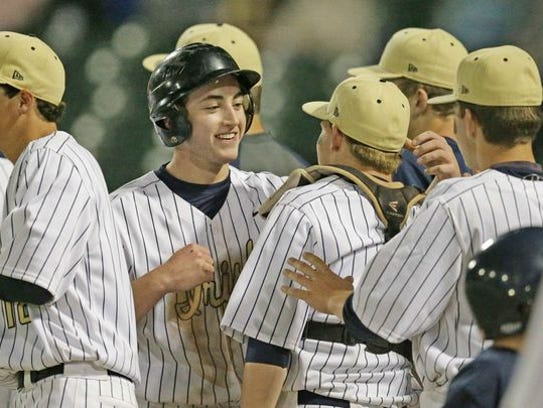 Cathedral senior Jared Poland (center) was named City