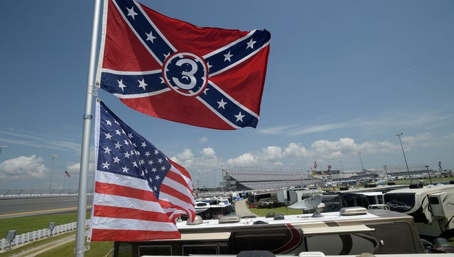 Confederate and American flags fly on top of a motor home at Daytona International Speedway on Saturday in Daytona Beach, Florida. NASCAR and the speedway offered to replace any flag a race brings to the track with an American flag.