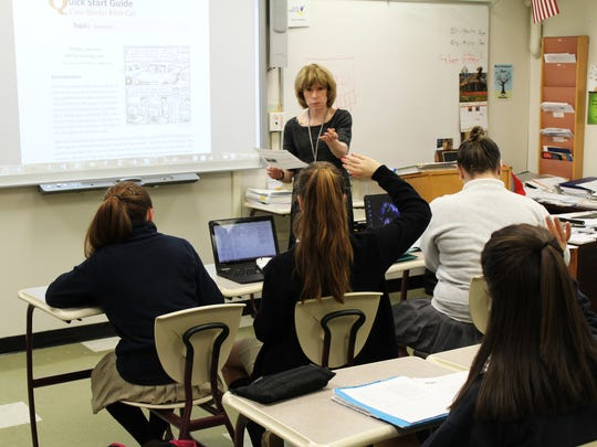 "Kathleen Brennan, Mathematics Chair and Economics Instructor at Mount Saint Mary Academy in Watchung, guides students in her ""Financial Math"" course to prepare for the future by making wise financial decisions."