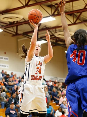 Emily Beard goes up for another shot during Dickson County's win over McGavock in the first round of the Region 6-3A tourney. The Lady Cougars defeated Overton Wednesday to advance to the region finals.