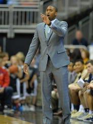 George Washington coach Maurice Joseph reacts to play