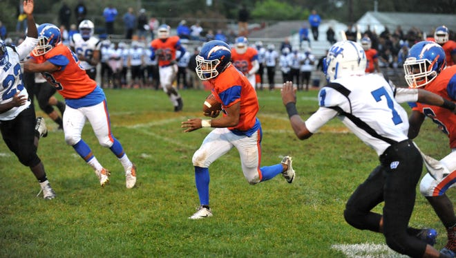 Millville's Marcial Ramos (2) rushes against Williamstown Friday, Sep. 30, 2016 at Barbose Stadium in Millville.