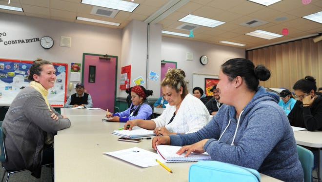 ESL student Hayde Santos, right, reads out sentences in English for the group, as teacher Jaimee DePompeo listens in. The Alisal Family Resource Center lends its multipurpose room to students of the Salinas Adult School for various classes.