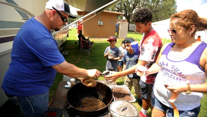 Anthony Elliott, with the Tiger Manufacturing cooking team hands out chili samples during the last year's Chili Super Bowl in Buffalo Gap.