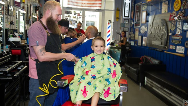 Jeronimo Ramirez is 4 years old and loves getting his hair cut by Roy Collins, and then heading to the game room for some old time video game play.