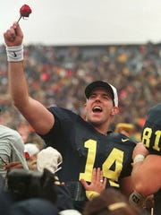 Michigan quarterback Brian Griese acknowledges the