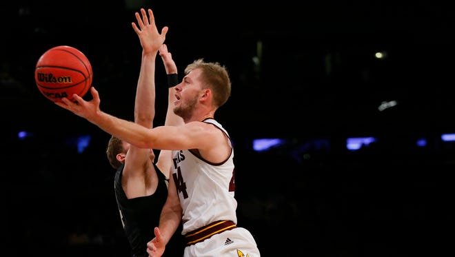 Arizona State Sun Devils guard Kodi Justice (44) goes to the basket against Purdue Boilermakers guard Ryan Cline (14) during first half at Madison Square Garden.