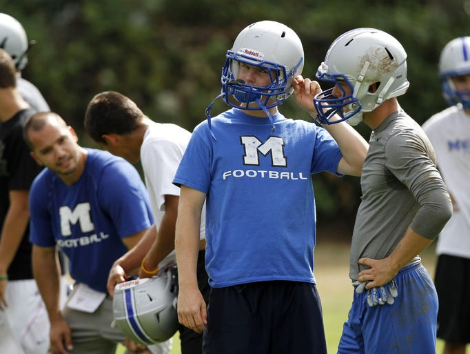 Members of the McNary High School football team practice on Wednesday, Aug. 20, 2014, in Keizer, Ore.