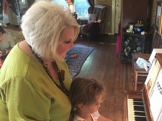 Catalina Alcocer, 5, practices her piano recital music during a lesson with Candis Rodgers Hicks. Hicks has taught piano lessons for 26 years to students ranging in age from 5 to 77.
