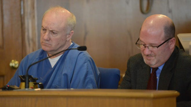 John William Gates, left, sits next to his attorney Scott Wood Wednesday afternoon, Oct. 8, 2014, in Fairfield County Common Pleas Court in Lancaster. Gates was sentenced to 44 years in prison for shooting his wife Brenda Gates in both of her legs. Brenda Gates' left leg was amputated as a result of the crime.