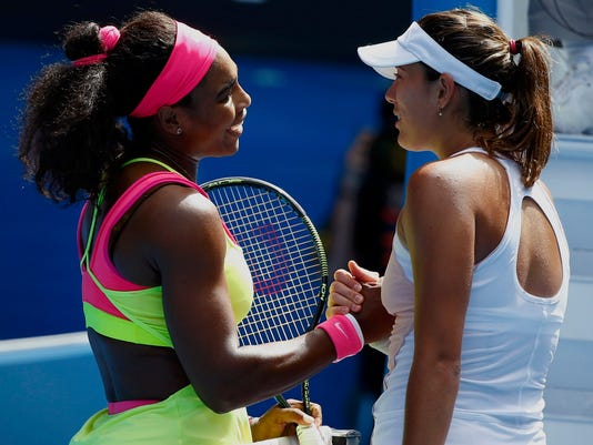 Williams of the U.S. shakes hands with Muguruza of Spain after winning their women's singles fourth round match at the Australian Open 2015 tennis tournament in Melbourne