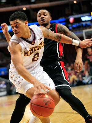 This file photo shows Rutgers Scarlet Knights guard Myles Mack (4) defending Minnesota Golden Gophers guard Nate Mason (2) during a game at the United Center in Chicago. The Gophers will host Miami in the Big Ten/ACC Challenge in November.