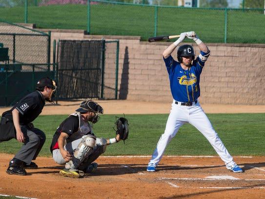 Blake Schmit (11) bats during an exhibition game on