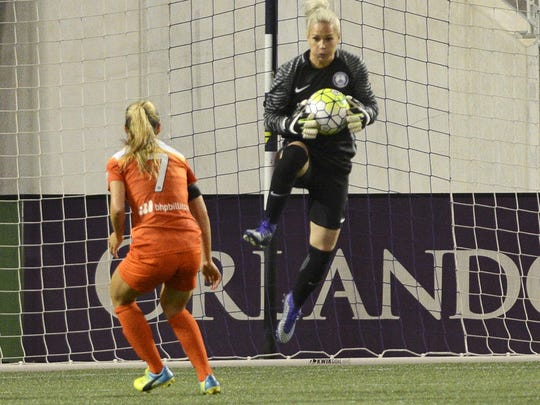 Ashlyn Harris makes a save during Saturday's home opener against Houston in Orlando.