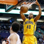 Detroit Pistons forward Marcus Morris (13) drives on Indiana Pacers guard Glenn Robinson III (40) during the first half of a preseason NBA basketball game in Indianapolis, Tuesday, Oct. 13, 2015. (AP Photo/Michael Conroy)