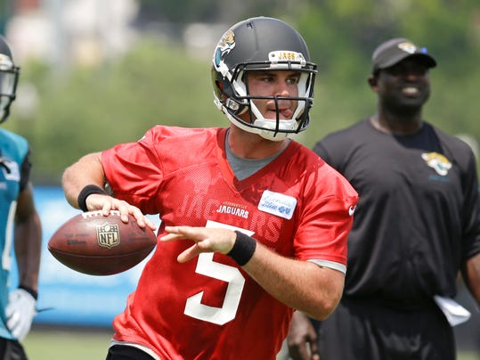 Jacksonville Jaguars quarterback Blake Bortles looks for a receiver during an NFL organized team activities football practice in Jacksonville, Fla., Tuesday, May 27, 2014. (AP Photo/John Raoux)