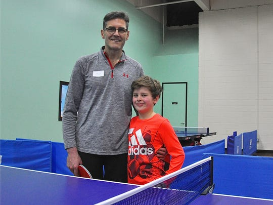 Arlon Bennett of Tappan with son Phelan after playing ping-pong at Westchester Table Tennis Center