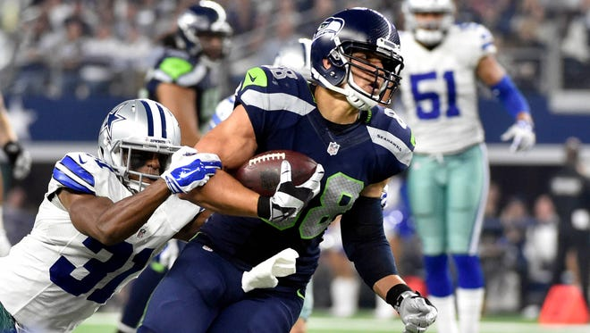 "Dallas Cowboys' Byron Jones (31) tackles Seattle Seahawks' Jimmy Graham (88) after Graham caught a pass in the second half of an NFL football game in Arlington, Texas. The 2015 NFL season has had plenty of flops such as Jimmy Graham's move to the Northwest, the ""lose-lose"" LeSean McCoy-Kiko Alonso trade and the Ndamukong Suh-Miami Dolphins marriage.(AP Photo/Michael Ainsworth, File)"
