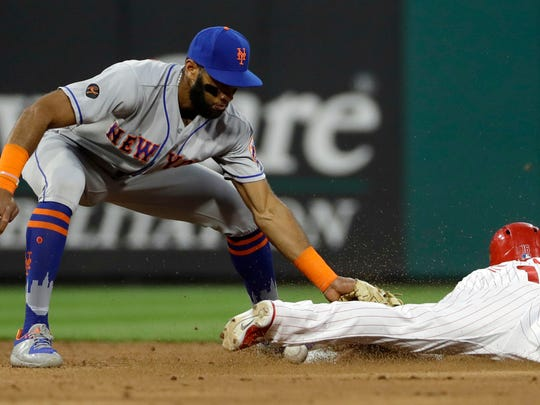 Philadelphia Phillies' Cesar Hernandez, right, steals second base past the empty tag from New York Mets shortstop Amed Rosario during the third inning of a baseball game Friday, May 11, 2018, in Philadelphia.