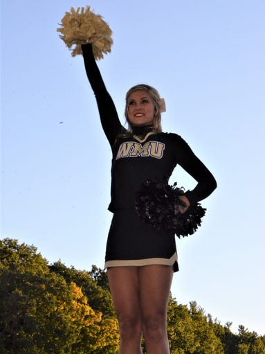 A Western Michigan cheerleader leads the crowd as the