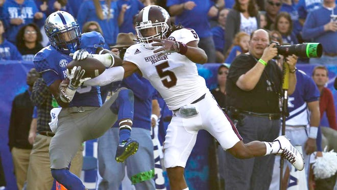 Kentucky's Demarco Robinson can't hold onto this end zone throw as Miss State's Jamerson Love threatens during first half action against No. 1 Miss. State Saturday at Commonwealth Stadium. Oct. 25, 2014 By Matt Stone/The C-J