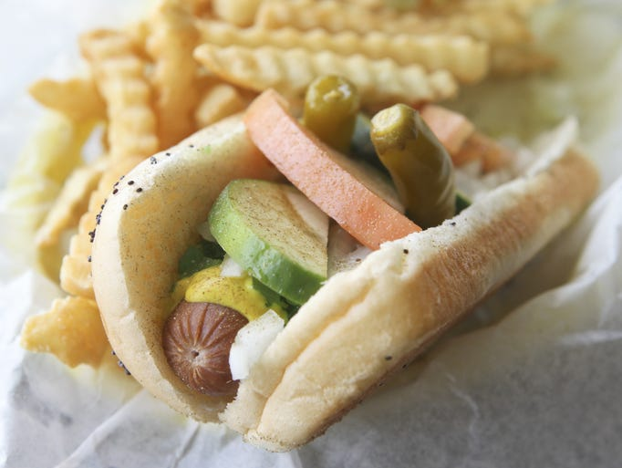 Lonnie's Taste of Chicago features offerings like the Clark Street hot dog, also known as the Chicago Style Hot Dog with Vienna Beef hot dog, yellow mustard, piccalilli relish, choped onions with tomato wedges and cucumbers.