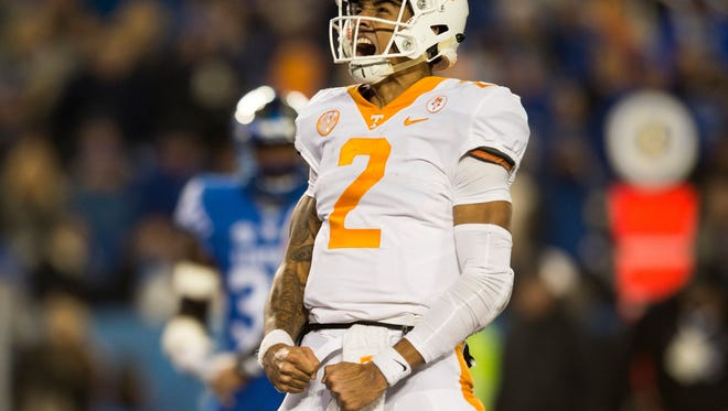 Tennessee quarterback Jarrett Guarantano (2) celebrates a touchdown during Tennessee's game against Kentucky at Kroger Field in Lexington on Saturday, Oct. 28, 2017.