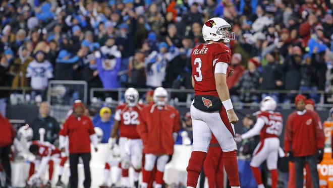 Arizona Cardinals quarterback Carson Palmer (3) looks up at the scoreboard after growing an interception late in the 2nd quarter of their NFC championship game against the Carolina Panthers Sunday, Jan. 24, 2016 Charlotte, NC