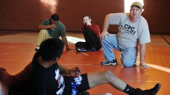 Norman Osteen has headed up Western North Carolina's Strong and Courageous wrestling club since 1989.