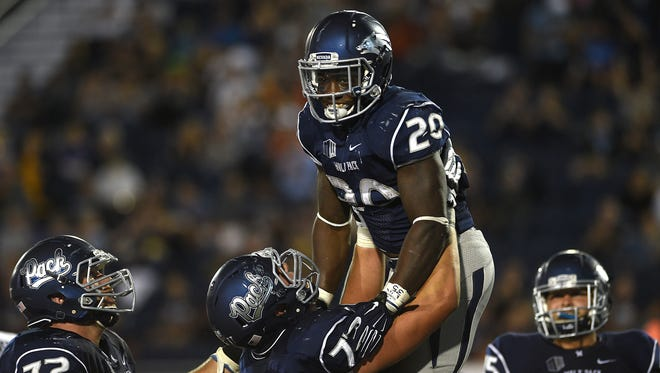 Nevada running back James Butler celebrates a touchdown last season. Despite the Wolf Pack's change to a more pass-happy system, Butler will still see his share of touches.