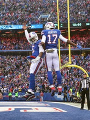 Bills quarterback Tyrod Taylor (5) celebrates with receiver Justin Hunter who caught what turned out to be the game winning touchdown in a 28-21 win over Jacksonville.