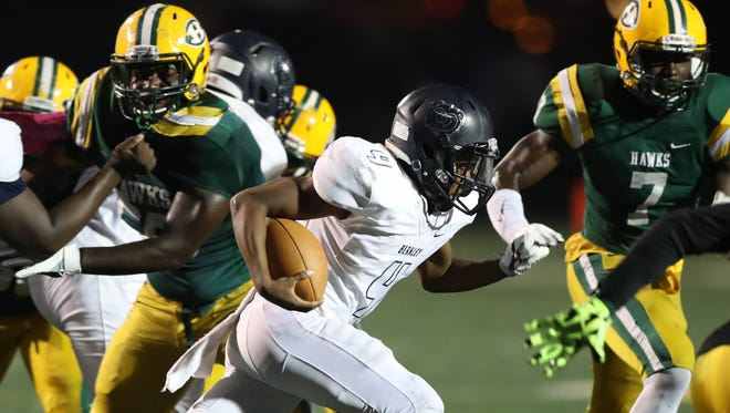 Farmington Hills Harrison defenders make the tackle against Berkley's David Long during the first half Harrison's 39-0 win over Berkley, allowing Herrington to set the record for most wins in state history on Friday, Oct. 13, 2017, at Harrison.