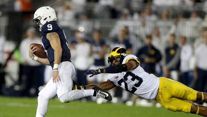 Michigan's Tyree Kinnel misses the tackle on Penn State's Trace McSorley defenders during first half action Friday, October 21, 2017 at Beaver Stadium in University Park , Pa. Kirthmon F. Dozier/Detroit Free Press