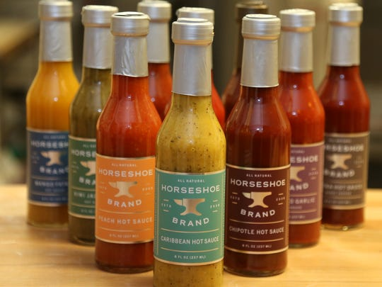 The complete line of Horseshoe Brand hot sauces, including the soon to be released Caribbean flavor at their production facility in Milan on March 29, 2018.