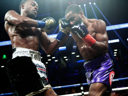 Errol Spence Jr., left, punches Lamont Peterson during the fifth round of an IBF welterweight championship boxing match Saturday, Jan. 20, 2018, in New York. Spence stopped Peterson in the eighth round. (AP Photo/Frank Franklin II)