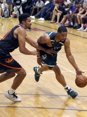 Miles Bridges, right, drives against Kenny Goins during a Moneyball Pro-Am game, Thursday, June 29, 2017, in Dimondale.