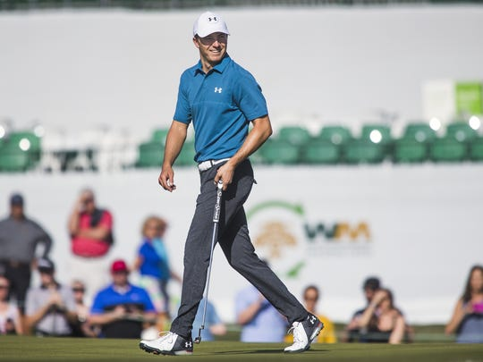Jordan Spieth appears happy with his approach shot