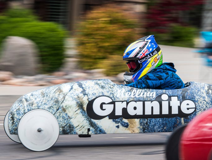 Competitors race downhill in the Rallystop Soap Box