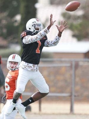 Miami defensive back Artie Burns goes up to intercept a pass during drills Tuesday.