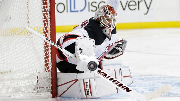 New Jersey Devils goalie Keith Kinkaid (1) stops a