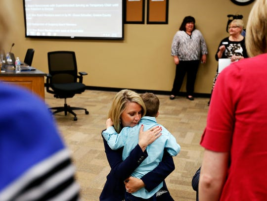 At a swearing in ceremony in April 2016, new Springfield school board member Alina Lehnert hugs her nephew.