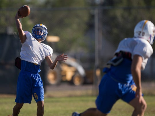 Odem's John Cantu passes the ball during practice on