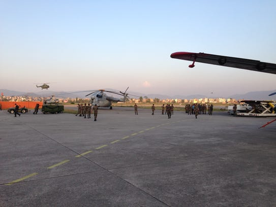 Military personnel work at the airport in Kathmandu,
