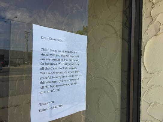 A sign on the door of China Restaurant lets patrons