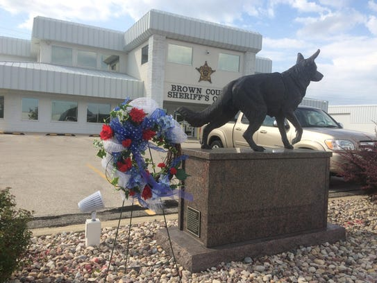 A police dog memorial outside the Brown County Sheriff's