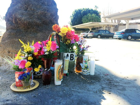 A memorial is set up at the site of the fatal shooting